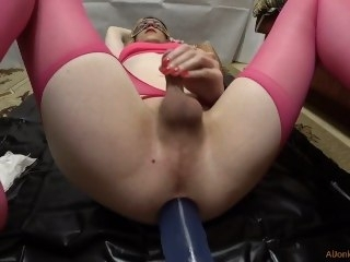 TS-girl in pink stockings is entertained with a transparent dildo fuck ass